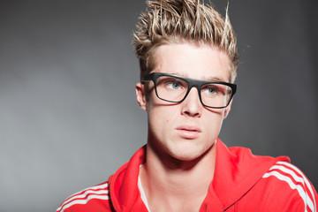 Fashion studio portrait young man with retro glasses.