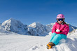 Ski, snow, sun and winter fun - skier girl playing in snow