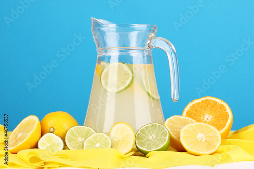 Citrus lemonade in glass pitcher of citrus around
