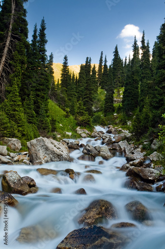 Long exposure image of mountain river falling and flowing trough
