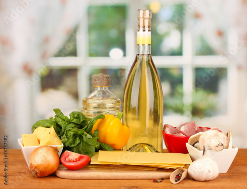Lasagna ingredients on bright background