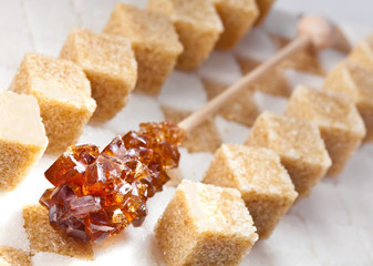 Cubes of not refined reed sugar and candy brown sugar