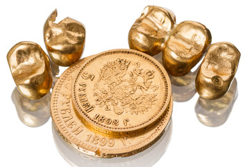 Gold dental crowns and  old coin