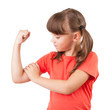 Little girl touches the biceps
