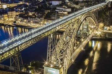 Dom Luis bridge over Douro river at night in Porto Portugal