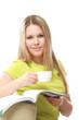 Pretty blonde woman enjoying reading on sofa
