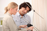Couple setting up an antenna