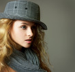 Young Blonde Woman with Hat and Scarf