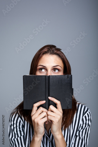 Young Woman Thinking Behind Her Diary