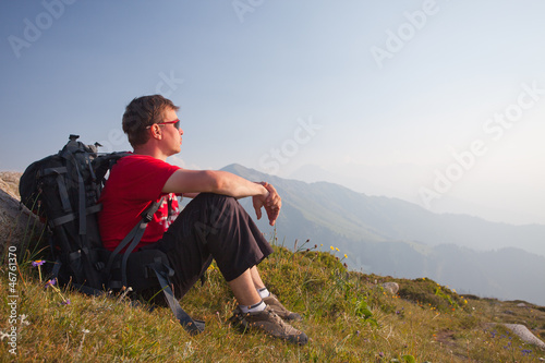 Young man relaxing after hiking