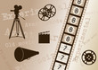 Movie camera, film strip, director clapper, megaphone and film r