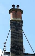 A tall chimney with struts