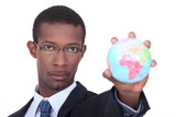 Businessman holding a globe
