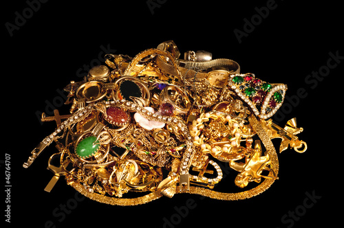 Pile of Gold Jewelry on Black Cloth Background