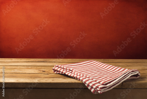 Background with wooden table, tablecloth and  grunge red wall