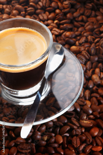 Black coffee on background of coffee beans