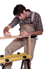 Man measuring wood frame