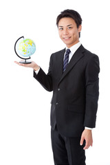 Young businessman with a globe