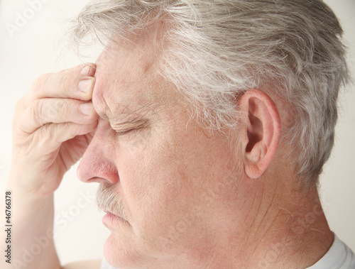 man with headache over eye
