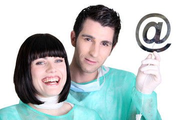 Doctors holding up the at symbol