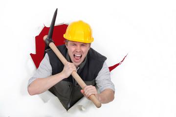 Tradesman bursting through a barrier