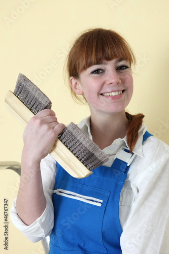 Decorator holding wallpaper brush
