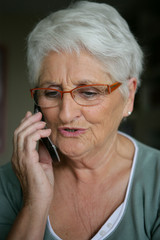 Elderly lady making telephone call