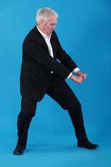 Businessman performing pull gesture