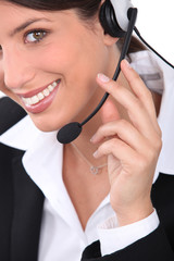 Young woman wearing telephone head set