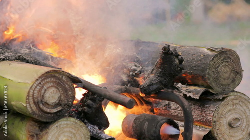 burning dead body in balinese funeral, bali, indonesia