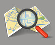 Folded map with magnifying glass