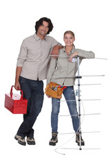Couple stood with television aerial