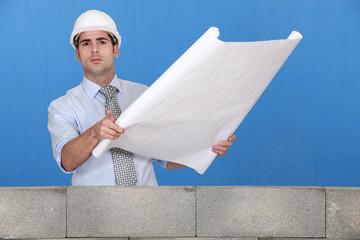 Engineer unrolling blurpints