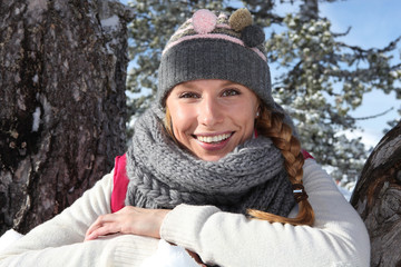 Woman dressed in appropriate snow clothes