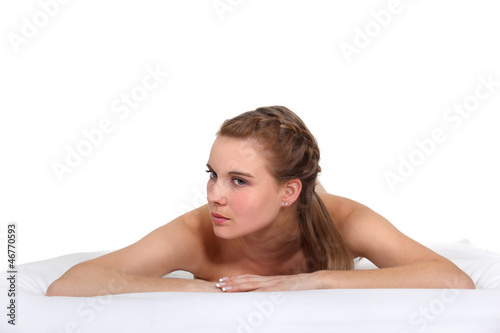 Woman laying naked in studio