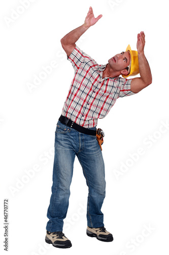 Construction worker holding empty copy space