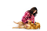 Woman tickling her dogs belly