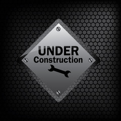 under construction sign on metal background vector