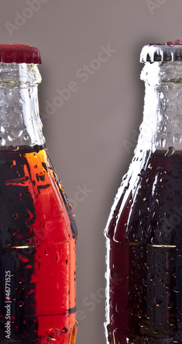 two bottles of cola soda