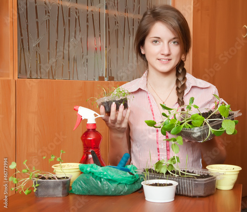 woman with various seedlings