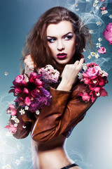 pretty attractive erotic woman in brown jacket with flowers