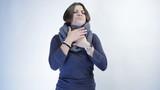 Beautiful woman has sore throat, isolated