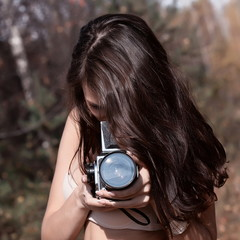 Woman with film camera