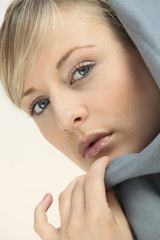 Blond woman wearing grey hood top