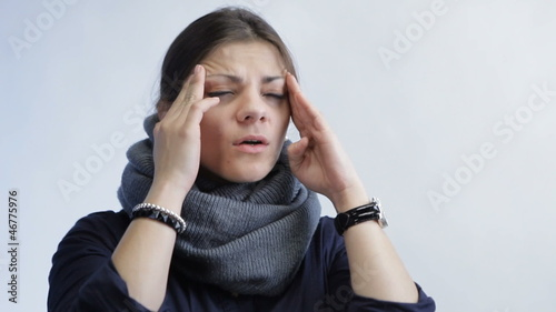 woman with headache isolated