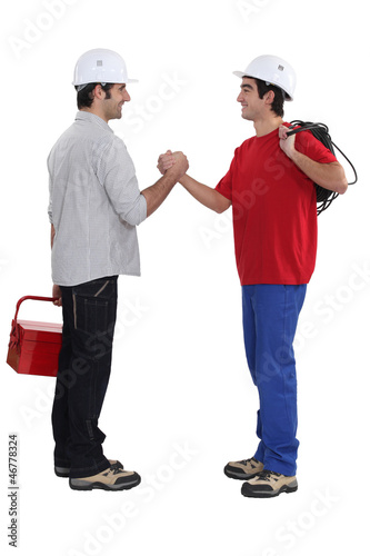 Two artisans greeting each other