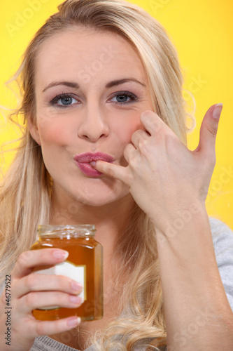 woman sucking her finger