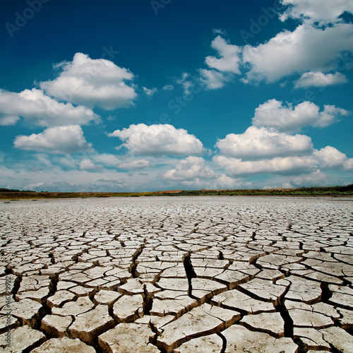 global warming. dramatic sky over cracked earth - 46779922