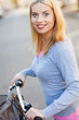 Portrait of woman with bike