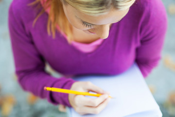 Female student writing in notebook